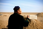 HENCHMAN: In the middle of a desert and oil felds near Zhanaozen there lies a muslim graveyard, where Alexandr was buried in October 2012. The Imam who responded the graveyard was singing next to a week old grave, just a moment before he had called the secret police to come and spy the visitors.